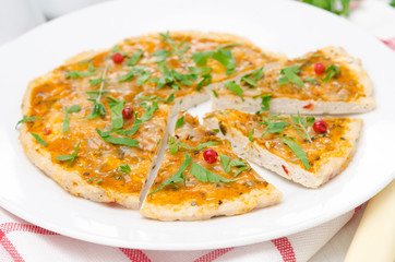 sliced chicken pizza with tomato sauce, cheese and herbs
