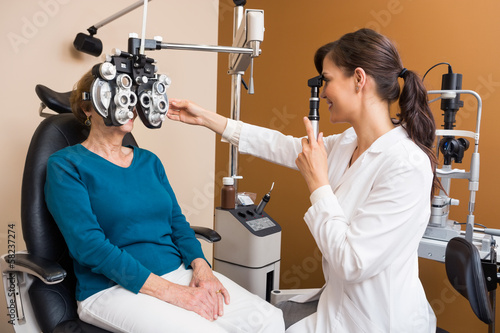 Optometrist Examining Senior Woman's Eyes