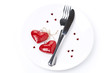 table setting for Valentine's Day with fork, knife and hearts