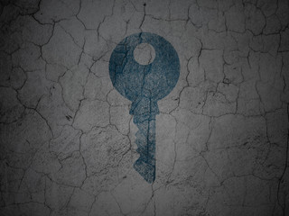 Safety concept: Key on grunge wall background