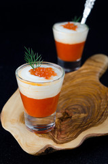 two appetizers of sweet pepper, cream and red caviar in a glass
