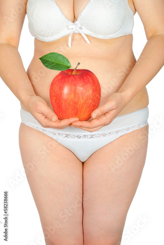 Fat woman with an red apple