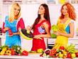 Group women preparing food at kitchen.