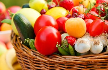 Basket full of organic fruit and vegetables
