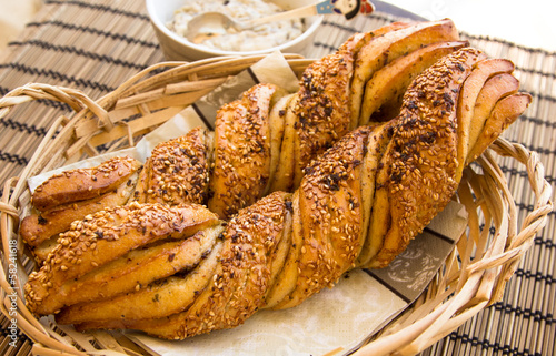 Breakfast still life with twisted bread with garlic and sesame s