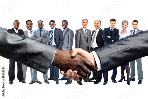 African American businessman shaking hands with caucasian
