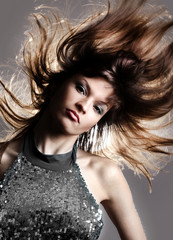 Portrait of beautiful and fashion model woman with blown hairs