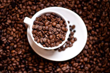 fresh black columbian coffee in white cup isolated