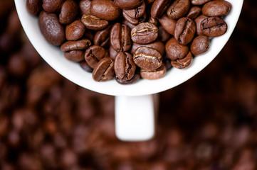 Detail, macro view of coffee mug with aromatic black coffee bean