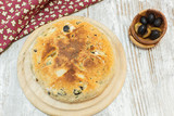 Focaccia bread with black olives.