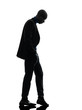 african black man standing looking down  silhouette