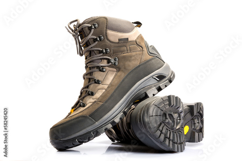 Leinwanddruck Bild A pair of new hiking boots on white background