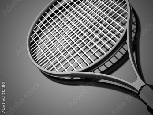 Black tennis racket rendered on dark