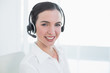 Businesswoman wearing headset in office