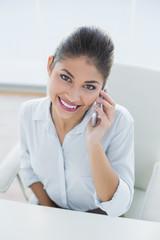 Elegant businesswoman using cellphone in office