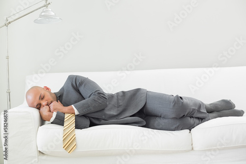 Elegant businessman sleeping on sofa