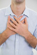 Mid section of a man with chest pain