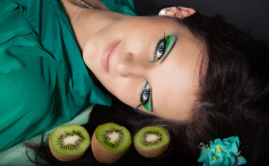 young woman with green makeup