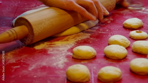 Woman preparing dough for baking