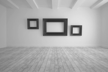 Big room with frames at wall