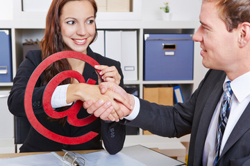 Business people shaking hands in internet sign