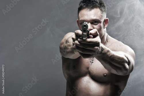 Serious Male Holding a Gun