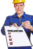 Construction worker holding evaluation checklist