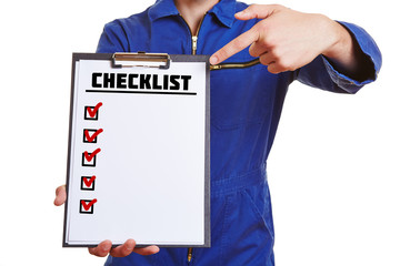 Construction worker holding clipboard with checklist