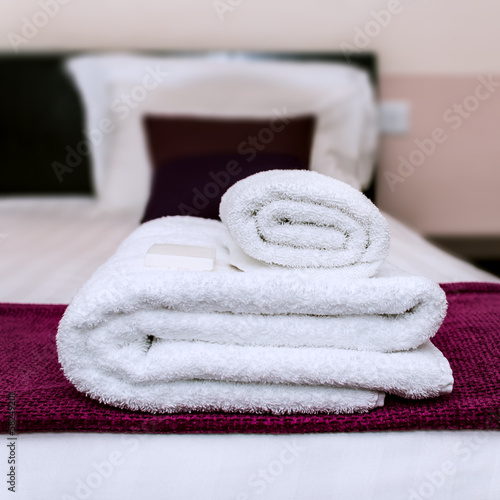 Closeup photo of clean towels and soap in a hotel room