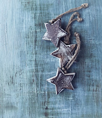 Wooden christmas stars on painted wood