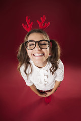 Cute smiling woman with headband with reindeer antlers