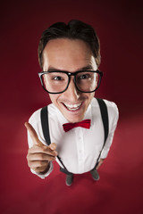 Funny nerdy man wearing big glasses