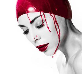 Dramatic portrait of a bleeding woman