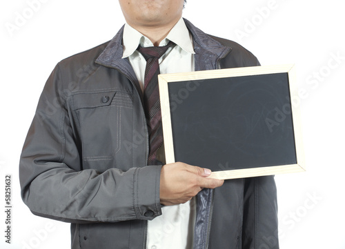 businessman holding blackboard