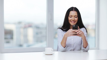 woman with cell phone sending text message