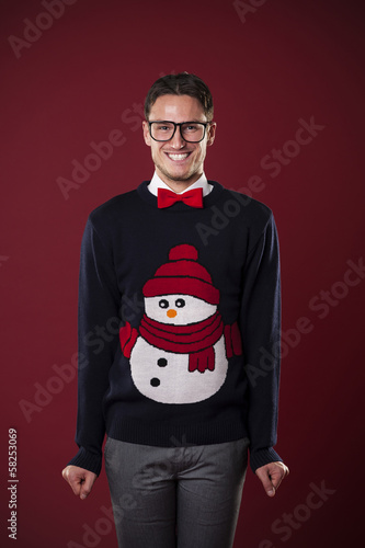 Portrait of funny man wearing sweater with snowman