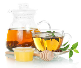 Teapot with mint tea and honey