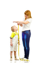 woman measuring child