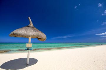 Tropical beach with umbrella in Mauritius