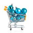Shopping cart full of christmas balls isolated on white backgrou