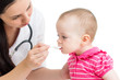 doctor giving remedy to baby girl