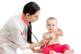 doctor examining baby girl