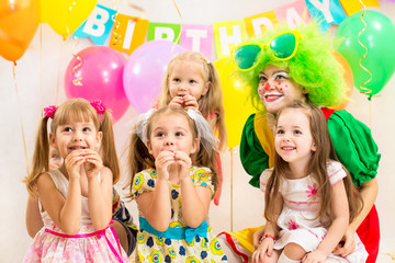 jolly children group and clown on birthday party