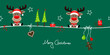 2 Sitting Christmas Reindeers Gift & Symbols Green