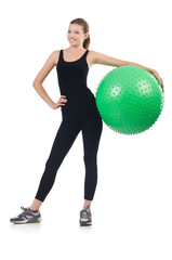 Young woman with ball exercising on whitee
