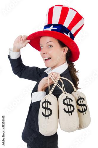 Businesswoman with sacks of money on white