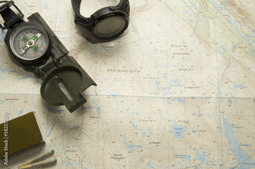 Compass and watch on map