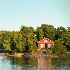 Scandinavian fisherman Red House on sea