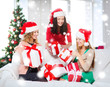 women in santa helper hats with many gift boxes