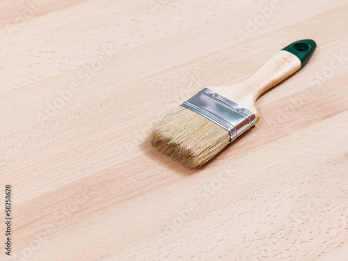 brush on surface of beech wooden table top